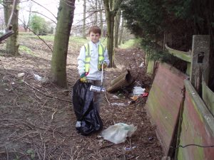 A young HopeforBelper volunteer takes part in the recent clean-up