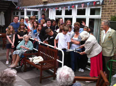 Opening of the garden at Ada Belfield - Councillor Jackie Cox wielding the sheers!